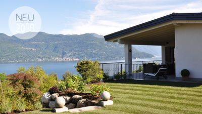 Photo for Holiday home with fantastic lake view and large private garden near the lake