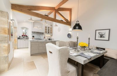 The impressive open plan kitchen/dining room blends contemporary style with traditional character