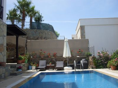 Photo for Gumusluk Sunset Apartment with EXCLUSIVE use of pool and garden