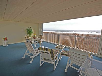 Photo for Decorated with beach decor, this 2 bedroom luxury oceanfront condo has free WiFi, an outdoor pool, and a covered balcony with a breathtaking ocean view and is located in midtown!