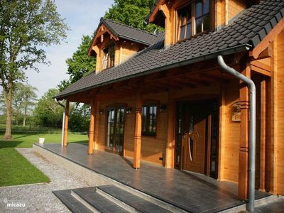 Photo for Luxury wooden villa Dirk with views over farmlands in wooded area