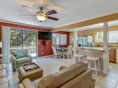 Nicely furnished 3/2 w/deck over looking pool, min. to beach!