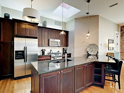 Kitchen - The modern kitchen is perfect for the master chef in your group.