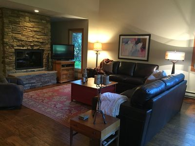Great Room with wood burning fireplace, and tons of wood in garage.
