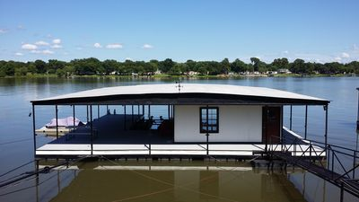 Private dock with 2 boat slips and 2 personal watercraft slips.