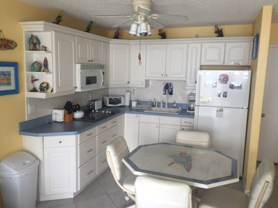 Updated kitchen w/octagonal table and swivel chairs