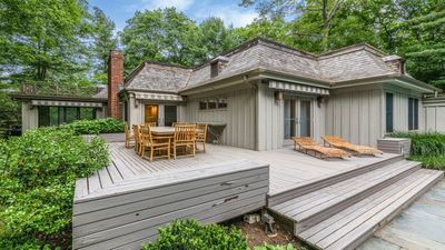 Photo for Chic East Hampton Northwest Woods Gem with Beautiful Den, Pool and Garage.