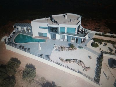 Photo for A new luxurious modern architect-designed open plan villa with stunning views