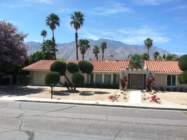 Front of the house with the mountains view. Spacious Newly Remodeled Home In The      HomeAway Palm Springs