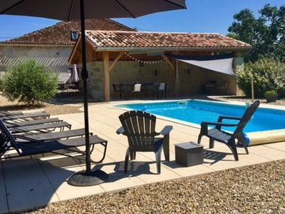 Photo for Impressive stone barn conversion in peaceful setting with pool and large garden