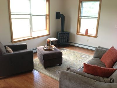 Living room with brand new furniture and cozy gas stove