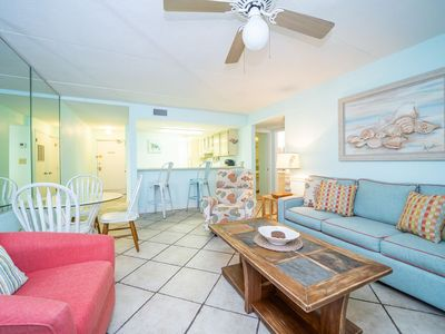 Coastal decor throughout the unit - Living Room, Dining area, & Kitchen area