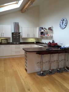 Kitchen area with breakfast bar