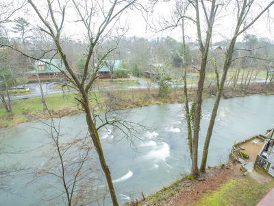 Photo for Lovely River front 2 bedroom condo with fireplace. Pool & hot tub on property.