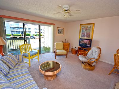 Cozy, inviting 1 bedroom condo with an outdoor pool and gorgeous canal-front view located uptown on the bayside just a few blocks from the beach!