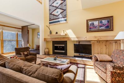 Living room with gas fireplace and television with Bluetooth speaker