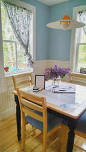 Cheery eat-in kitchen with view to the yard/deck.  Lovely spot to enjoy meals!