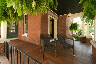 The wrap around front porch is a great place to be part of downtown happenings.