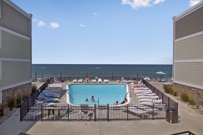 View of private pool and Lake Michigan from between the two buildings.
