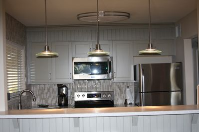 Modern kitchen with all new appliances, countertops and custom tile backsplash