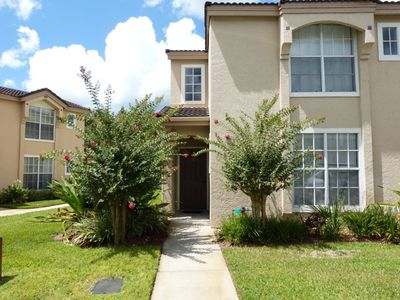 Photo for 3 bed 2 bath townhome with screened porch and heated community pool & spa at gated community Mango Key near Disney, Orlando, Florida