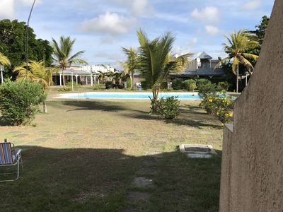 Photo for Secure bungalow with communal pool 100 meters from the beach of Grand-Baie