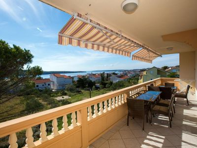 Photo for Three bedroom apartment with terrace and sea view Barbat, Rab (A-16245-c)