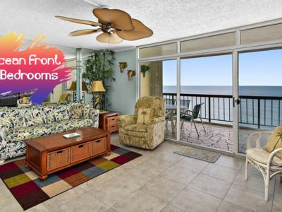 Photo for Comfortable, spacious 2 bedroom oceanfront condo with tropical decor, free WiFi, an indoor pool, and a wonderful view of the ocean located uptown mere steps to the beach!