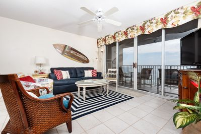 Stunning views from the oversize glass balcony doors. - NEW furniture and furnishings in this lovely tiled Gulf front living room.