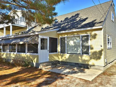 Photo for FREE Activities. Swedes St Dewey Beach, Lovely seaside cottage with fabulous front porch, huge back yard, sun room, 4 bedrooms and 2 baths