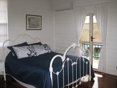 The Blue bedroom is huge and opens onto the front verandah. It is has air-con