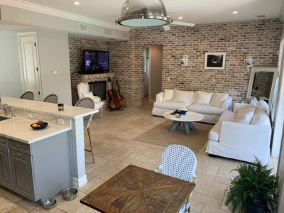 Bright, airy light filled family room abutting kitchen and overlooking pool area
