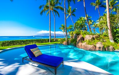 Private Beachfront Heated Pool with Grass Lawn