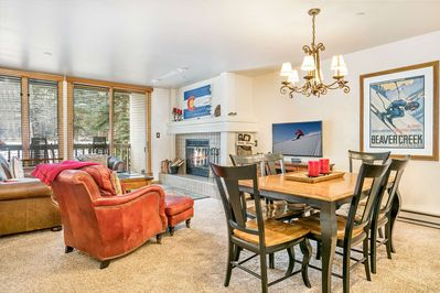 Inviting living room with wood burning fireplace and deck access with seating for 2.