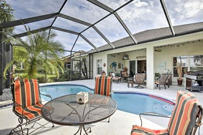 Soak up the sun from the backyard of this Tampa vacation rental house.