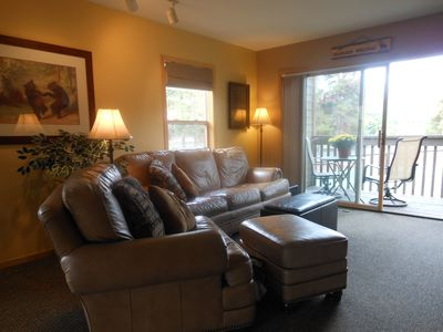 Inviting living room in this side unit has plenty of sunshine, winter and summer