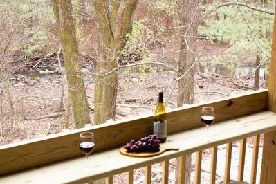 Unwind by the creek.  A relaxing spot on the deck to let your cares float away.