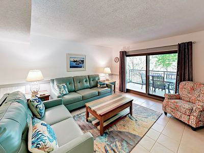 """Living Room - 2 large sofas provide a great space to sprawl out and watch the 50"""" flat screen TV."""