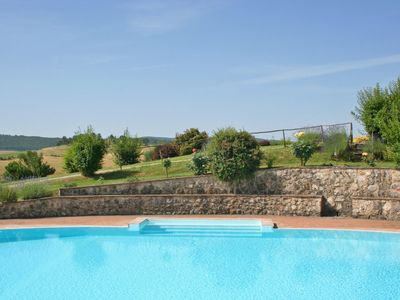 Photo for Lovely apartment with WIFI, pool, patio, washing machine, panoramic view, parking, close to Siena