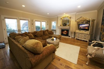 Enjoy time with the family in this great living room and balcony with ocean view