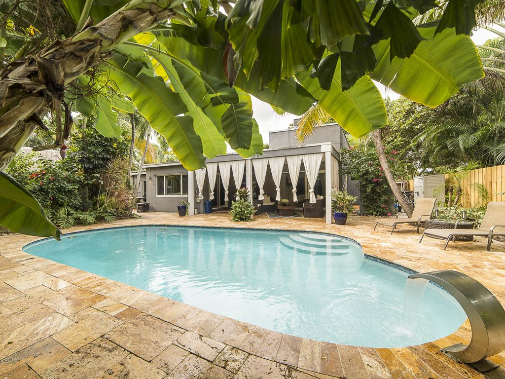 "Welcome to the  ""Hidden Oasis"" 3 bedrooms 2.5 Bathroom Tropical Pool Home!!!"