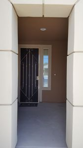 Outside front entry, recessed entry with security gate