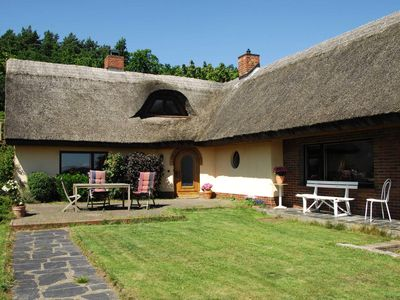 Photo for The Reedhaus am See - fantastic location with lake view - the Thatched Cottage on the lake - fantastic location - lake view
