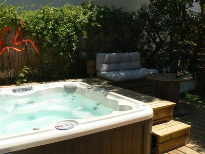 Photo for A corner of paradise with Jacuzzi 2 steps from the lake and the ocean