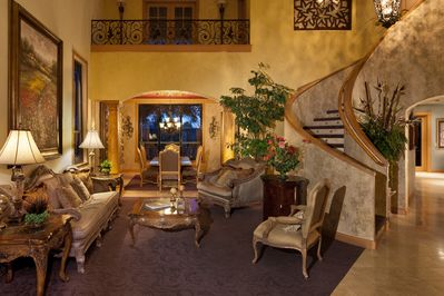 The formal living area with the dining room and stairway leading up to the beds.
