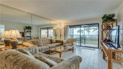 Bright and comfortable living room overlooking the  beautiful Gulf views