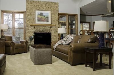 Family room with fireplace and 60' flat screen TV