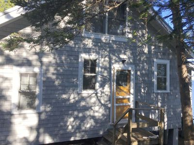 Classic Maine camp with a wooden screen door!
