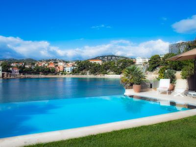 Photo for OUTSTANDING Luxury villa, feet in the water on the beach Renecros