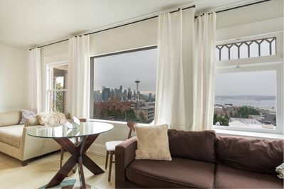 The living room with a view of the Space Needle
